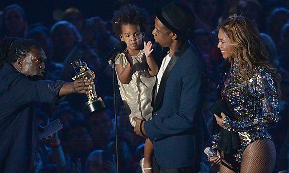 Blue Ivy Carter Jay Z and Beyonce accept the Video Vanguard Award at the 2014 MTV Video Music Award